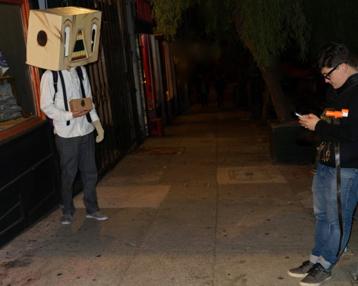 Halloween Box Head Man Ignored by Texting Man by Lynn Friedman on Flickr