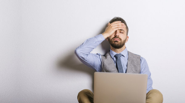 Frustrated Man Using Computer